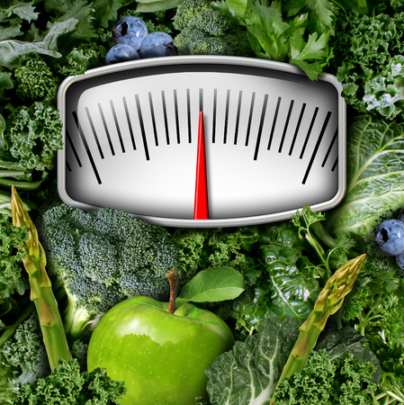 leafy: Fruits and vegetables weight scale concept as a group of natural food as broccoli apple blue berries and green leafy produce with a measuring meter as a symbol for healthy diet nutrition and fitness lifestyle. Stock Photo