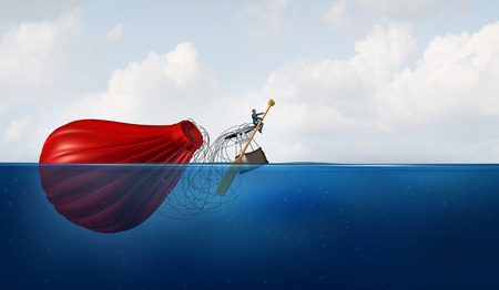 salvaging: Problem Manager as a businessman in the water with a sunk hot air balloon paddling the failed vehicle towards a new destination as a business metaphor for recovery and to persevere when confronting a crisis. Stock Photo