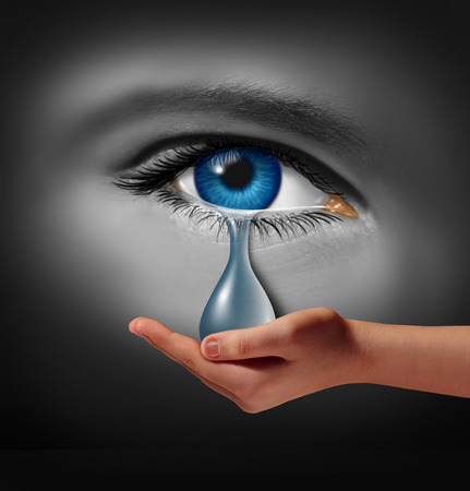 Depression support and therapy concept as a depressed human eye crying a tear held by a helping hand as a metaphor for solutions in the the treatment of mental health issues through psychotherapy or medication.