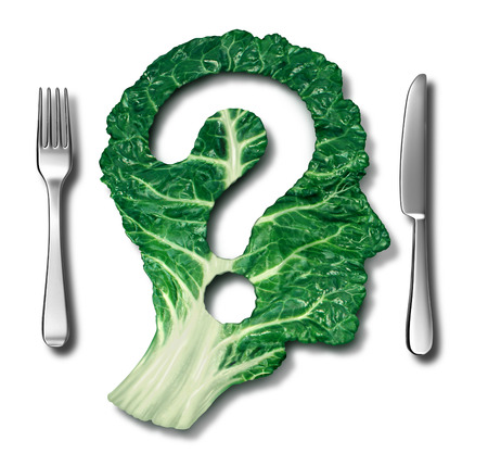 Healthy eating questions and green diet concept as a leafy vegetable in the shape of a question mark as a symbol of good high fiber health food eating and information on natural nutrition in a dinner place setting on white.