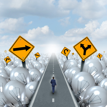 Lightbulb road and Idea path and creative pathway business concept as a businessman walking through a highway as a light bulb group with traffic signs as a symbol and metaphor for innovation success leadership. Stock Photo