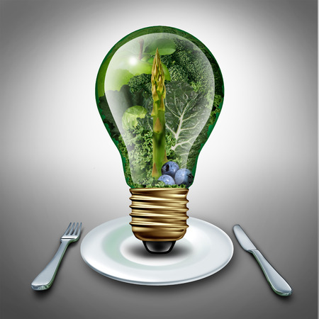 Eating healthy idea and diet tips concept as a lightbulb with fruits and vegetables inside as an inspiration symbol for health food lifestyle and fresh produce ideas for dinner or lunch. Stock Photo