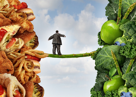 Diet change healthy lifestyle concept and having the courage to accept the challenge of losing weight and fighting obesity and diabetes as an overweight person walking on a highwire asparagus from fatty food towards vegetables and fruit.