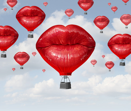 romantic kiss: Love balloons as a hot air balloon made of human red lips soaring up to the blue sky as a surreal dreamy romantic passion concept and emotional trip or freedom discovery travel.