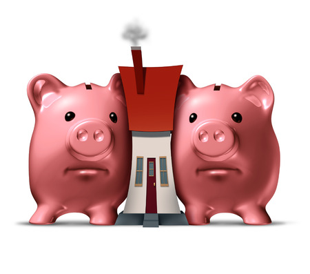 house prices: Housing crunch and home crisis concept as two piggy banks putting the squeeze on a family house as an economic symbol of feeling financial pressure and finance stress from realestate mortgage prices and renovation expenses.