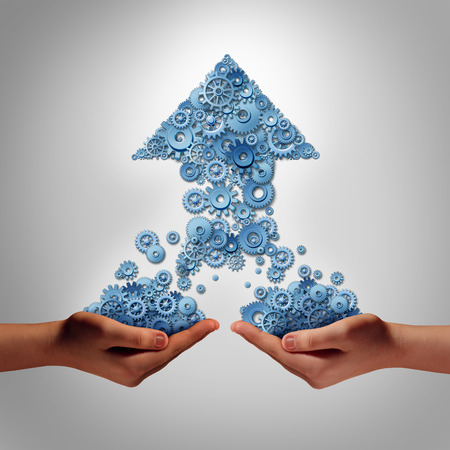 Teamwork for success business concept as two hands holding groups of gears and cogs that have come together to form an upward arrow as a symbol for financial team work growth partnership building together.