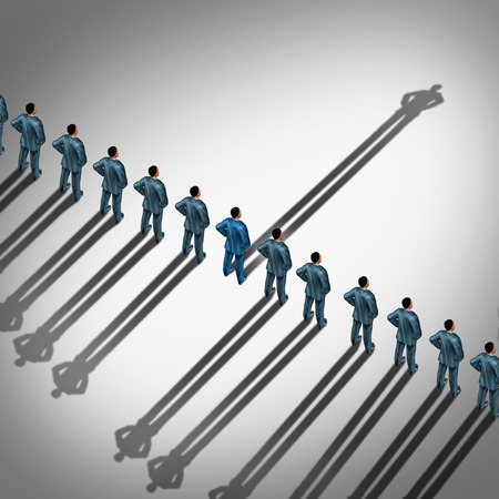 alone in crowd: Different business thinking and independent thinker concept and new leadership concept or individuality as a group of people cast shadows with the shadow of one businessman going in the opposite direction as a business icon for innovative thinking. Stock Photo