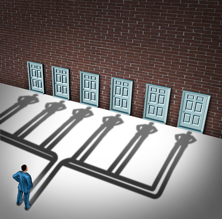 business success: Businessman door choice concept as a person deciding to choose the right doorway with a cast shadow of multiple people from a group of entrance possibilities as a metaphore for increasing the odds of career success. Stock Photo