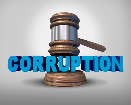 criminal act: Corruption concept as a justice judge gavel or mallet coming down on the words that represent the criminal act of bribery and fraud as a legal metaphor for dishonest immoral behavior.