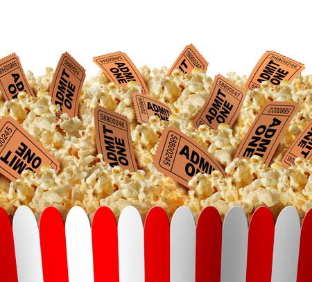 feature films: Movie popcorn tickets border as a group of popped corn snacks with cinema ticket stubs in the food as a theatrical symbol for entertainment and the arts on an isolated white background. Stock Photo