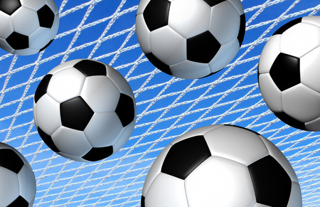 fitness goal: Soccer sport goal concept as a group of european football balls flying into a net with a sky background as a fun summer activity and fitness symbol or scoring success metaphor. Stock Photo