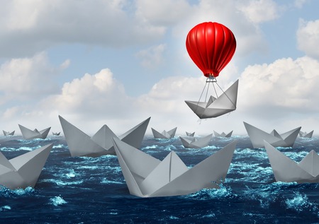 different strategy: Business advantage concept and game changer symbol as an ocean with a crowd of paper boats and one boat rises above the rest with the help of a red hot air balloon as a success and innovation metaphor for new thinking. Stock Photo