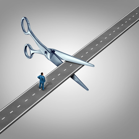 to cut: Work interruption concept and interrupted career path as a businessman on a road  that is being cut by scissors as a layoff metaphor and symbol for job and employment limits or cutting benefits and opportunity for promotion or advancement. Stock Photo