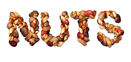 brazil nut: Nuts symbol as letters made with a mixed assortment of raw seeds pecan with walnut brazil nut peanut,hazelnut pistachio almond and cashew as a healthy food symbol and nutritious protein isolated on a white background.