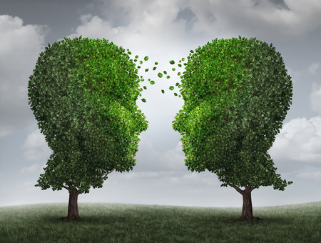 interaction: Communication and growth concept as a growing partnership and teamwork exchange in business with two trees in the shape of human heads on a sky with leaves exchanging from one face to the other as a concept of cooperation.