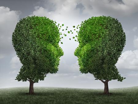 communication: Communication et la croissance concept comme un échange croissant de partenariat et de travail d'équipe dans les affaires avec deux arbres en forme de têtes humaines sur un ciel avec des feuilles échange d'une face à l'autre comme un concept de coopération. Banque d'images