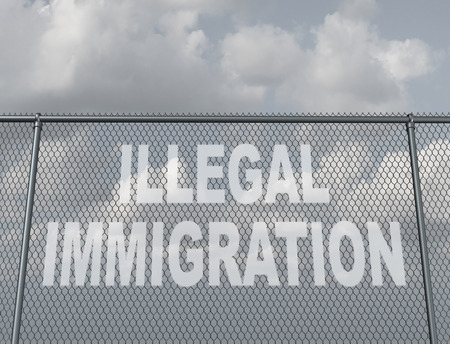 illegal immigrant: Illegal immigration concept as a chain fence with a hole shaped as text that represents people illegaly crossing a national border violating the migration law of the country as undocumented immigrants. Stock Photo