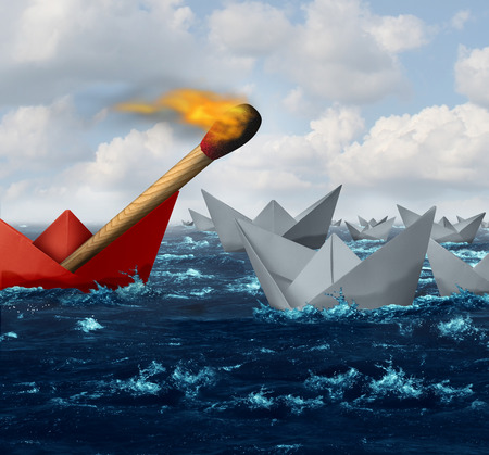 disruptive: Destructive business and disruptive technology and innovation concept or individuality as a group of paper boats in the ocean with one individual red boat carrying a match on fire headed towards the competition as a metaphor for new industry danger.