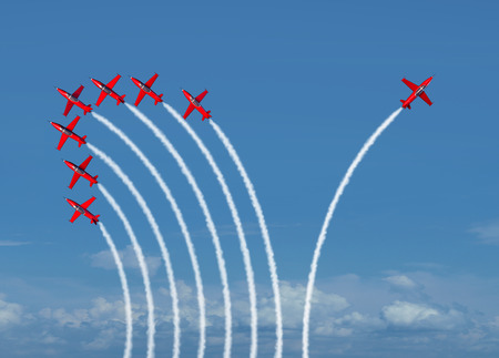 Independent innovation and new thinking concept or leadership symbol of individuality as a group of flying jet airplanes with one individual airplane going in the opposite direction as a business icon for innovative thinker.