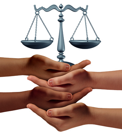 Community legal assistance concept with a group of hands representing diverse groups of people cooperating together to provide law and justice support and advice holding a justice scale.