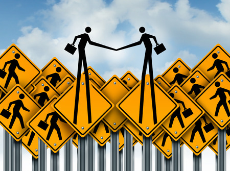 breaking out: Partnership success and group cooperation concept as a team of worker crossing traffic signs with two businessman icons breaking out shaking hands in agreement.
