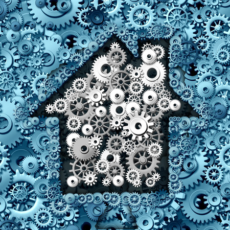 real business: Real estate business concept as house or home automation made of gears and cog wheels as a symbol for investing in residential construction ideas and mortgage financing or a smart home symbol. Stock Photo
