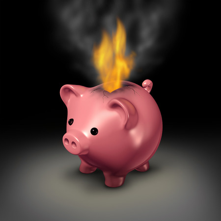 wasteful: Burning money and careless spending financial concept as a piggy bank with flames and smoke coming out because of currency on fire as a business or family budget debt crisis metaphor.