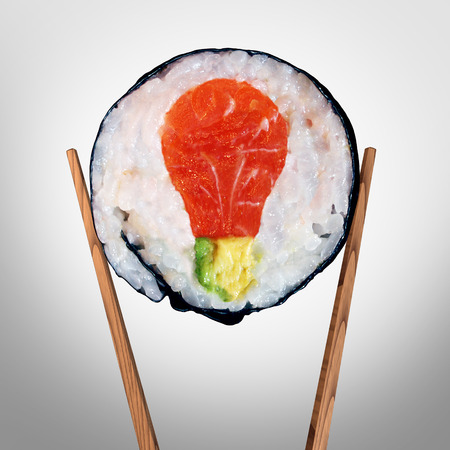 Sushi idea and Japanese food concept as a sushi roll with raw salmon and avocado shaped as a light bulb representing fresh creative asian cuisine solutions and cooking inspiration. Фото со стока