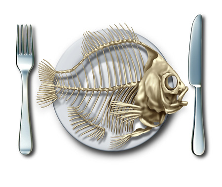 aquaculture: To the bone concept eating fish or bankrupt idea as a place setting with a fork and knife with an empty seafood skeleton on a plate as a business metaphor for debt or as a food hunger icon.