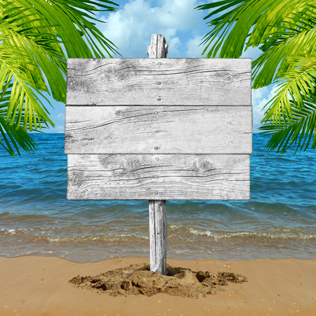 Beach wood sign and tropical vacation blank billboard background as an ocean wave on sand with palm tree leaves as a travel symbol for tourism and traveling information with copy space. Stockfoto