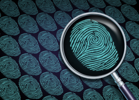 fingerprint: Identity search concept or choosing the right employee as a recruitment and human resource symbol with a magnifying glass in a close up of a finger print or fingerprint as a security information technology metaphor.