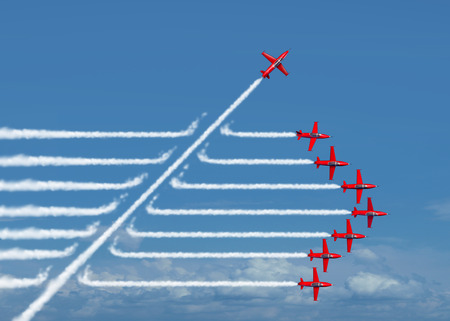 airplane: Game changer business or political change concept and disruptive innovation symbol and be an independent thinker with new industry ideas as an individual jet breaking through a group of airplane smoke as a metaphor for defiant leadership. Stock Photo