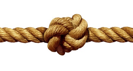 stress: Rope knot isolated on a white background as a strong nautical marine line tied together as a symbol for trust and faith and a metaphor for strength or stress.