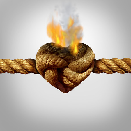 relationship breakup: Divorce and separation concept as a rope with a burning knot shaped as a love heart as a relationship problem symbol or infidelity crisis icon between a couple.