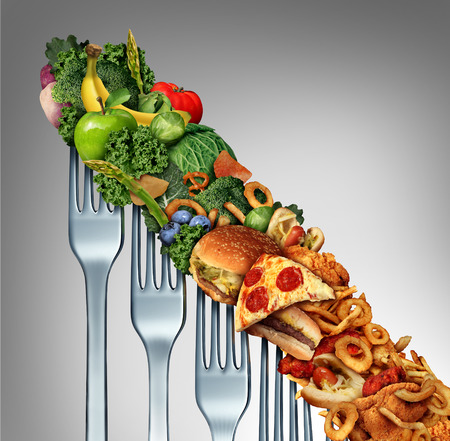 low fat diet: Diet relapse change as a healthy lifestyle slowly goes downward to greasy unhealthy fast food concept as a dieting quality decline symbol of returning to bad eating habits as a group of descending forks with meal items on them. Stock Photo