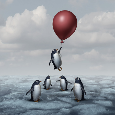 Penguins: Advantage business concept and leadership innovation metaphor as a group of penguins standing on ice with one individual rising up with a balloon as a motivation and new idea symbol.
