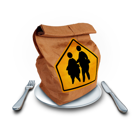 lunchtime: School obesity problem and children lunch diet social issue as a nutrition crisis concept as a brown paper lunch bag with two overweight fat kids on a a crossing traffic sign as a nutrition risk symbol for the youth.