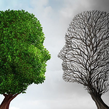 Social ecology and environment change or global warming environmental concept as a scene cut in two with half showing a  healthy green growing plant and the opposite a dead tree shaped as a human head caused by pollution. . Foto de archivo