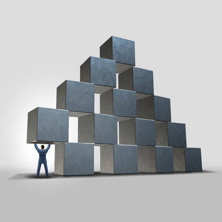 Business help concept as a businessman holding up and providing important urgent advice and support to an organization represented by a group of blocks as a success and leadership metaphor.