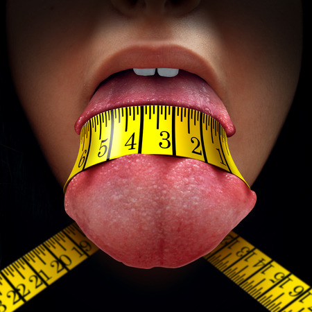 diet concept: Calorie restriction concept as a tape measure wrapped tight around a human tongue as a fasting diet or dieting symbol for anorexia or dietary control. Stock Photo