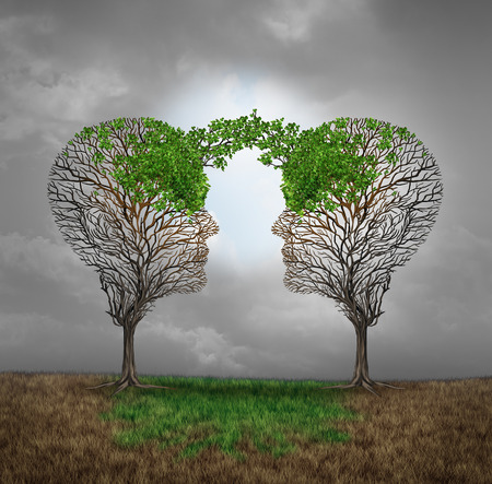 tree linked: Mutual support and saving one another as a benefit to each other business concept as two sick trees with new leaves growth emerging shaped as a human head providing a revival for success. Stock Photo