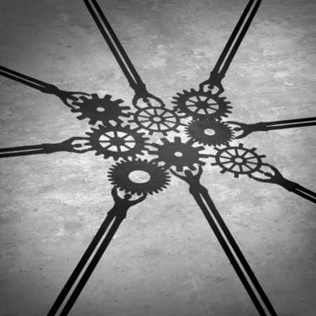 partnership strategy: People teamwork holding gears connected together as a social community group symbol or business concept working for a common cause with cast shadows holding a cogwheel network in a corporate team partnership. Stock Photo