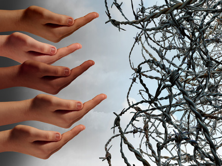 hatred: Refugee crisis concept as a group of hands from refugees in distress reaching with open hands asking for help faced with barbed wire fence keeping the suffering people out as a global social issue symbol.