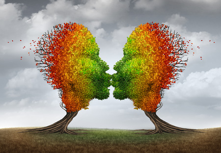 sex symbol: Aging couple relationship symbol and losing sex drive concept or low sexual desire metaphor as two trees shaped as kissing human heads losing leaves as in autumn season.