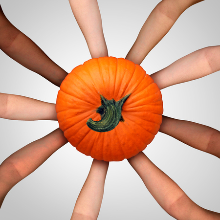 asian produce: Community harvest concept as an ethnicaly diverse multicultural group of people holding a ripe pumpkin as a social cooperation symbol for thanksgiving dasy celebration and autumn harvesting time or Halloween season.
