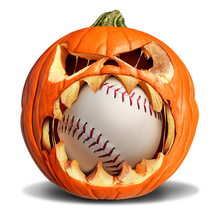 Autumn baseball concept as a pumpkin jack o lantern biting into a leather softball as a symbol for halloween sports and fall sporting events on a white background. Archivio Fotografico