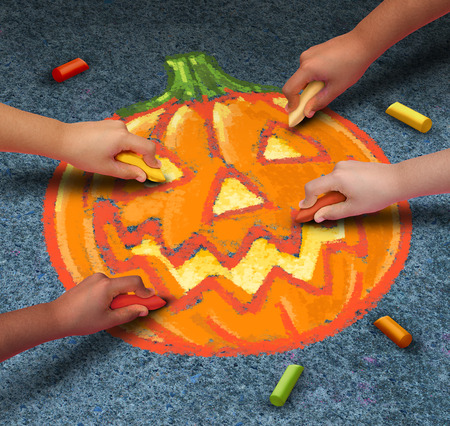 participation: Halloween children drawing a jack o lantern pumpkin with chalk on the outdoor pavement as festive autumn season symbol for community participation in fun activities.