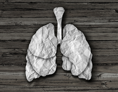 bronchioles: Human lung concept or healthy lungs organ made of cut crumpled white paper on an old wood background representing the medical anatomy of the respiratory system to provide oxygen to the body.
