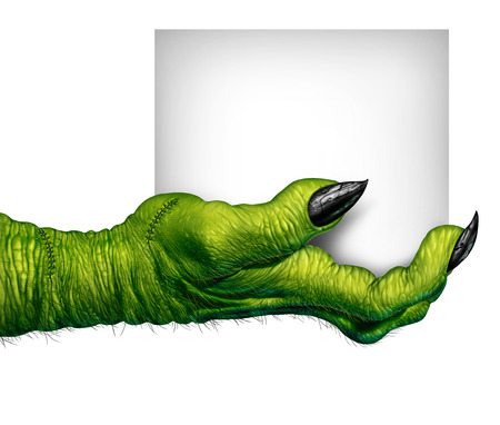 halloween symbol: Monster hand holding a sign as zombie fingers with  blank card as a creepy halloween or scary symbol with textured green skin wrinkled scary fingers and stitches isolated on a white background Stock Photo