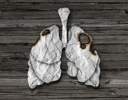 aparato respiratorio: Concepto humano del cáncer de pulmón o enfermedad y la pérdida de los pulmones humanos símbolo de cuidado de la salud como una disminución de la función respiratoria causada por una enfermedad tumoral como el órgano de papel blanco arrugado con agujeros quemados en un fondo de madera.